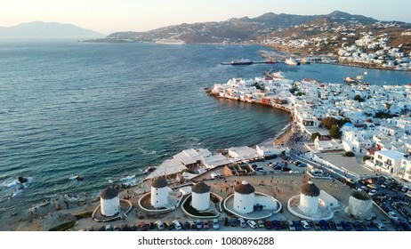 Aerial drone, bird's eye view of iconic windmills in Chora of Mykonos island next to little Venice, Cyclades, Greece