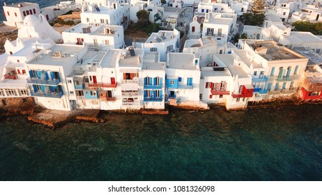 Aerial drone, bird's eye view photo from iconic Little Venice at sunset with beautiful colours, Mykonos island, Cyclades, Greece