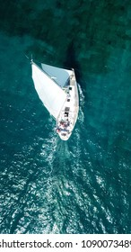 Aerial drone bird's eye view photo of luxury sail boat cruising in crystal clear waters of Ionian sea, Ionian islands, Greece
