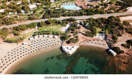 Aerial drone bird's eye view of famous resort near archaeological site of Cape Sounio with clear turquoise water beach, Attica, Greece
