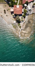 Aerial drone bird's eye view photo from famous city of Chalkida with clear water seascape and traditional character, Evia island, Greece