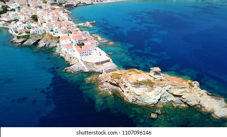 Aerial drone bird's eye view of iconic and picturesque Andros island chora, Cyclades, Greece