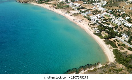 Aerial drone bird's eye view photo of famous sandy beach of Agios Petros near port of Gavrio, Andros island, Cyclades, Greece