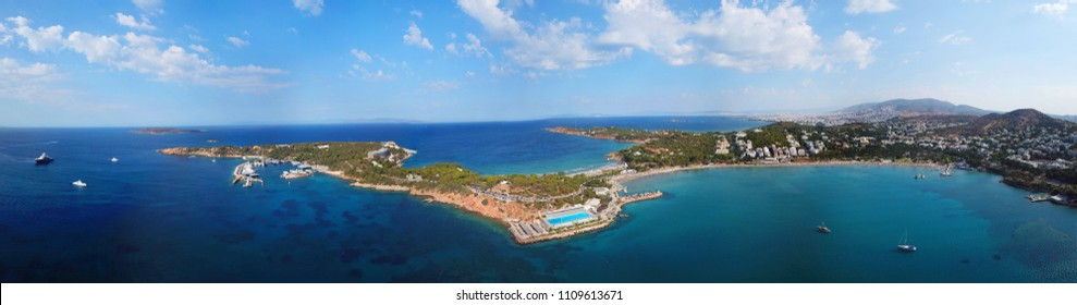 Aerial drone bird's eye view panoramic ultra wide 180 degrees photo of iconic Astir beach and Peninsula, Vouliagmeni, Athens riviera, Attica, Greece