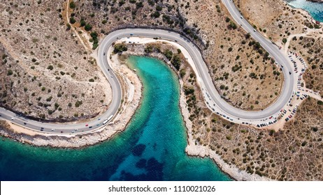 Aerial drone bird's eye view photo of road in Athens riviera seaside known limanakia forming small bays with turquoise clear waters, Vouliagmeni, Attica, Greece