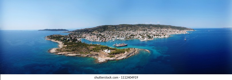 Aerial drone bird's eye view Panoramic photo of maginficent historic town in island of Spetses with traditional character and neoclassic houses, Saronic gulf, Greece