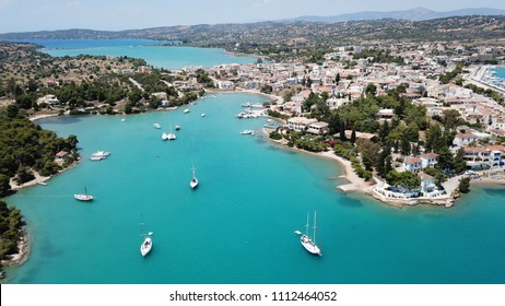 Aerial drone bird's eye view photo of famous and picturesque yacht dock seaside fjord village of Porto Heli with turquoise and emerald clear waters, Argolida, Peloponnese, Greece
