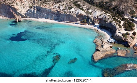Aerial drone bird's eye view of iconic volcanic white chalk iconic beach of Firiplaka, Milos island, Cyclades, Greece