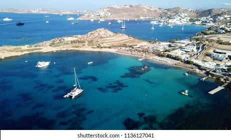 Aerial drone bird's eye view from famous beach of Paraga featuring famous night club of Skorpios and Santanna with largest pool in Europe, Mykonos island, Cyclades, Greece
