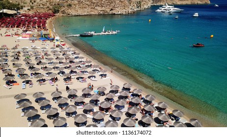 Aerial drone, bird's eye view photo of iconic and famous beach of Super Paradise with sapphire and emerald clear water sea, Mykonos island, Cyclades, Greece