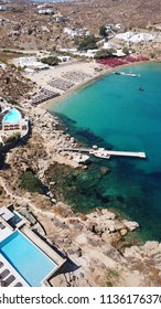 Aerial drone, bird's eye view photo of iconic pool club in famous Super Paradise beach, Mykonos island, Cyclades, Greece