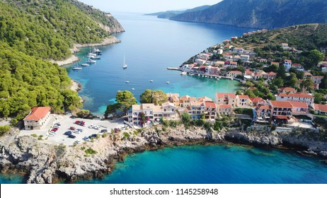 Aerial drone bird's eye view photo of beautiful and picturesque colorful traditional fishing village of Assos in island of Cefalonia, Ionian, Greece