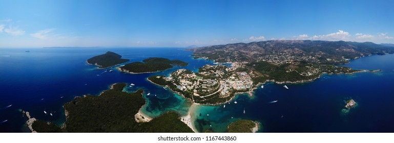 Aerial drone bird's eye view panoramic photo of iconic village and bay of Sivota, Epirus, Greece