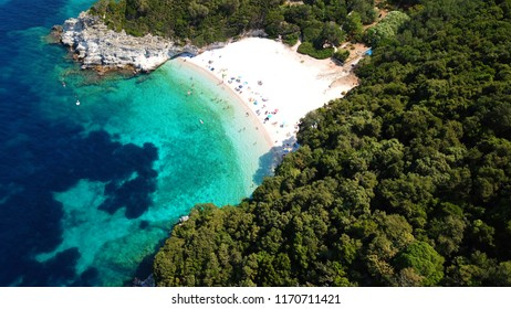 Aerial drone bird's eye view of tropical caribbean beach with emerald clear waters and lovely nature