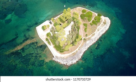 Aerial drone bird's eye view photo of iconic small island of Pontikonisi or Mouse island in area of Kanoni, Corfu island, Ionian, Greece