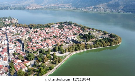 Aerial drone bird's eye view photo of iconic city and castle and mosque of Ioannina surounded by famous lake and mountains of Pindus, Epirus, Greece
