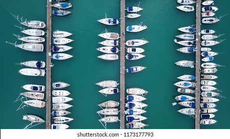 Aerial drone bird's eye view photo from popular Marina full of yachts and sail boats in Lefkada city waterfront, Ionian, Greece