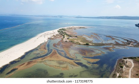 Aerial drone bird's eye view photo of tropical and exotic coral reef forming an atoll archipelago with open ocean