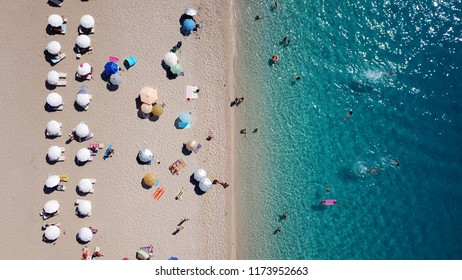 Aerial drone bird's eye view photo of iconic beach of Milos with turquoise clear waters in island of Lefkada, Ionian, Greece