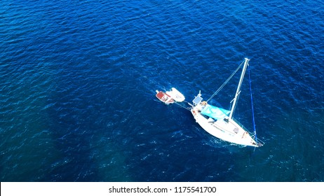 Aerial drone birds eye view of sail boat cruising in the Aegean sea, Greece