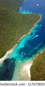 Aerial drone bird's eye view photo of iconic paradise sandy beaches with turquoise sea in complex islands of Agios Nikolaos and Mourtos in Sivota area, Epirus, Greece