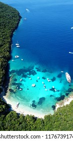 Aerial drone bird's eye view photo of iconic paradise sandy beach of blue lagoon with deep turquoise clear sea and pine trees  in complex island of Mourtos in Sivota area, Epirus, Greece