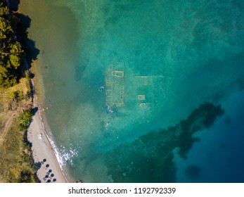 Aerial drone bird's eye view photo of antique Sunken City of Epidauros, Greece