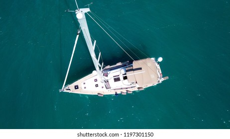 Aerial drone birds eye view of sail boat docked in the Ionian sea, Greece