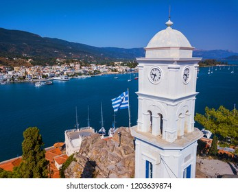 Aerial drone bird's eye view photo of the clock tower of Poros island, Greece.