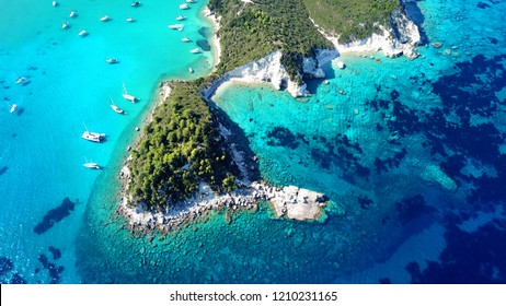 Aerial drone bird's eye view of tropical exotic mediterranean bay with luxurious yachts and turquoise sea