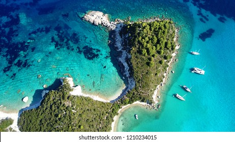 Aerial drone bird's eye view photo of iconic small port and fishing village of Lakka with traditional Ionian architecture and sail boats, Paxos island, Ionian, Greece