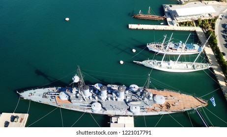 Aerial drone bird's eye view of small port and Park of Maritime Tradition where historic Averof warship is docked, Floisvos, Faliro Marina, Attica, Greece