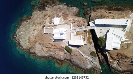 Aerial drone, bird's eye view of iconic church of Hrysopigi in picturesque island of Sifnos, Cyclades, Greece