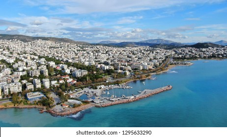 Aerial drone bird's eye view of small marina with boats docked in Voula, Athens riviera, Attica, Greece