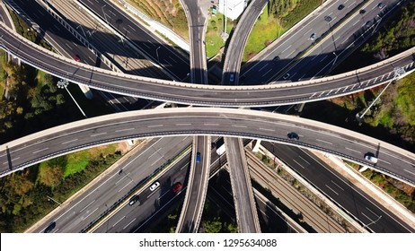 Aerial drone bird's eye view photo of latest technology cross shape multi level road highway passing through city centre