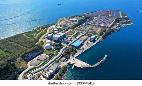 Aerial drone bird's eye view photo from island of Psitaleia the largest sewage treatment plant in Europe, Saronic gulf, Peiraeus, Attica, Greece