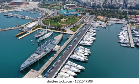 Aerial drone bird's eye view of small port and Park of Maritime Tradition where historic Averof warship is docked, Flisvos, Faliro Marina, Athens riviera, Attica, Greece