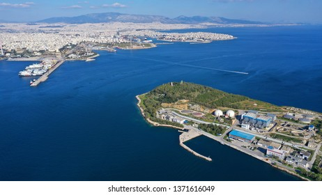 Aerial drone bird's eye view photo from island of Psitaleia the largest sewage treatment plant in Europe, Saronic gulf, Piraeus, Attica, Greece