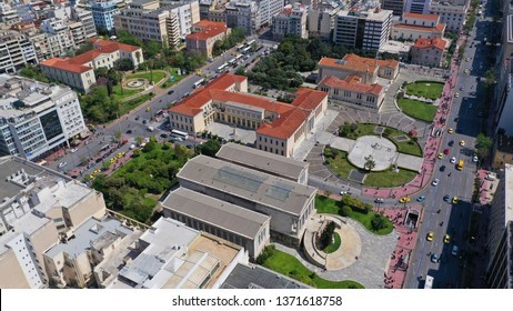 Aerial drone bird's eye view of iconic neoclassic University, Academy and public Library of Athens, Athens historic center, Attica, Greece