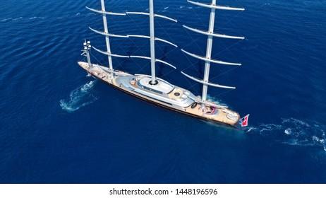 Aerial drone birds eye view of sail boat cruising in the deep blue Aegean sea, Greece