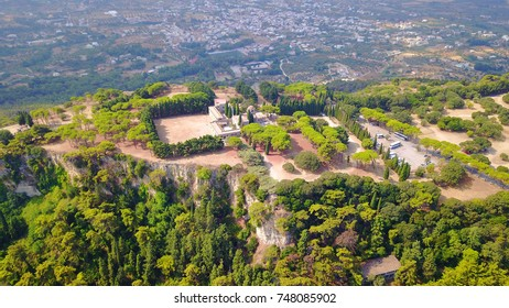 Aerial drone bird's eye view of famous hill of Filerimos with iconic Monastery and cross, Rhodes island, Dodecanese, Greece