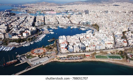 Aerial drone bird's eye view photo of iconic round shaped port of Marina Zeas with boats docked next to port of Piraeus, Attica, Greece