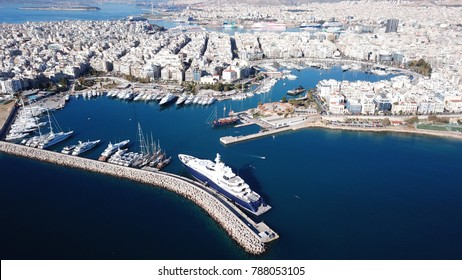 Aerial drone bird's eye view of iconic port of Piraeus with boats docked, Attica, Greece