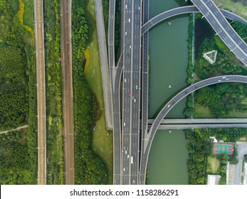 Aerial drone flight over evening road traffic. Two-level road junction. Top view.