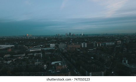Aerial drone flight over London England, UK.  Emirates stadium in mid-ground. London skyline.