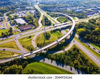 Aerial drone flight over a road junction. Neighborhoods of Leesburg Virginia - Shutterstock ID 2044924166