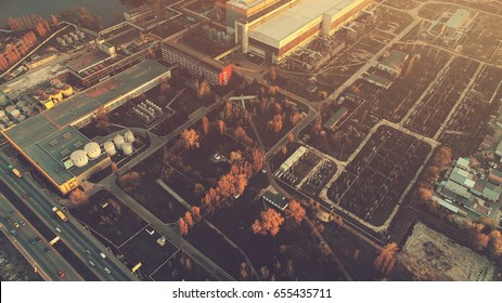 Aerial Drone Flight Photo over industrial zone of Kiev, Ukraine. Urban buildings, factory, power plant. Top view. Instagram vintage filter toning. Abstract futuristic cityscape in sunset soft light