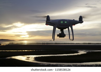 Aerial drone flying over calm ocean at sunset. Beautiful evening sky