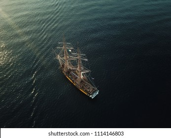 Aerial drone footage of a tall ship anchored in the south of Italy near Napoli and Vesuvius.