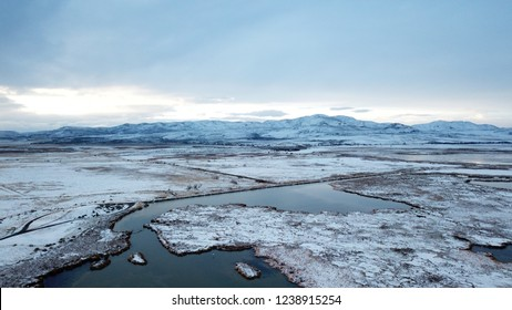Aerial drone image of Bear River Refuge covered in snow. Northern Utah, Box Elder County.